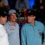 Mike Matusow, Erick Lindgren, and Orel Hershiser watch the final table