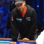 Daniel Negreanu stands as he watches his bracelet hopes disappear