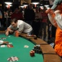 Ray Foley reacts to a winning flop as Brandon Cantu looks on