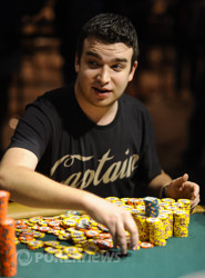Chris Moorman stacks chips after winning a big pot.
