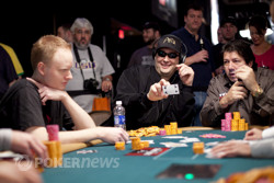 Phil Hellmuth shows Jon Turner the 4 of clubs, thus busting him out of the tournament.
