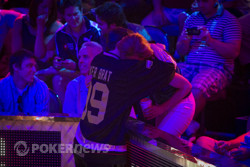 Phil Hellmuth hugs his wife after his huge double up.