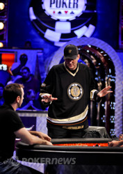 Phil Hellmuth, right. talks to Brian Rast after the last hand before dinner break.