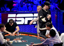 Phil Hellmuth pumps a fist.