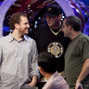 Scott Seiver is congratulated by Phil Hellmuth and Matt Glantz