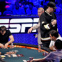 Phil Hellmuth pumps a fist after winning a pot.
