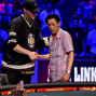 Phil Hellmuth shakes hands with Minh Ly, who he eliminated in 3rd.