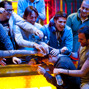 Rocco Palumbo's rail mobs him after winning the WSOP Gold Bracelet