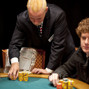 Tournament Director Robbie Thompson stacks Will Failla's chips