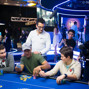 Team PokerStars Pros Jonathan Duhamel and Vanessa Selbet get a good laugh while Antonio Esfandiari massages Bill Perkins