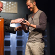 Athanasios Polychronopoulos accepting his bracelet from Nolan Dalla