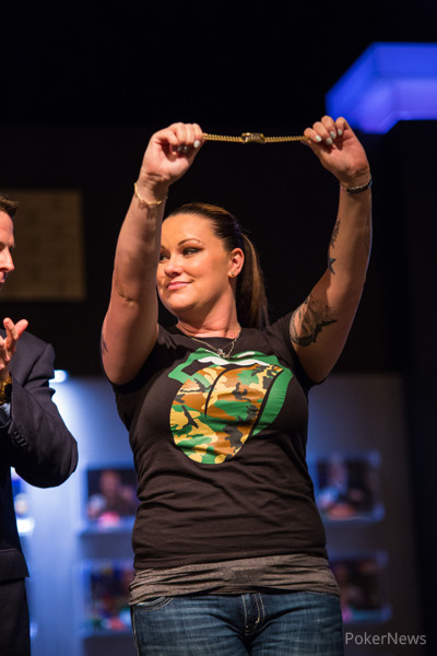 Dana Castaneda holds her bracelet aloft