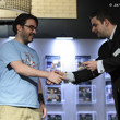Jack Effel presents the gold bracelet to Sean Dempsey for Event 39