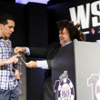 Nolan Dalla presents the gold bracelet to Hugo Pingray, Winner of Event #51: $1,500 No-Limit Hold'em Monster Stack