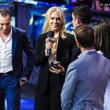 Catherine Bachard presents the One Drop winner's bracelet to Daniel Colman