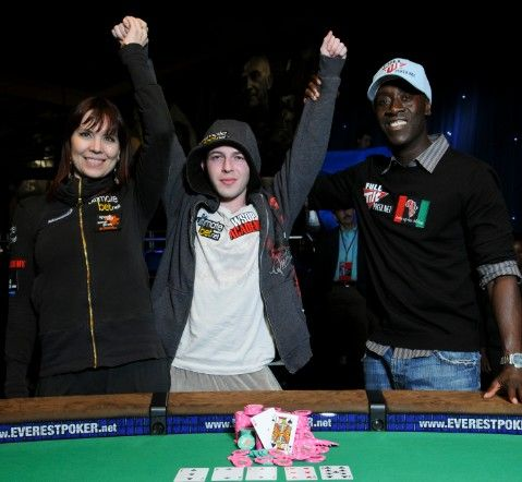 Alex Bolotin celebrates his win with Ante Up For Africa co-hosts Annie Duke and Don Cheadle.  (Photo courtesy World Series of Poker.)