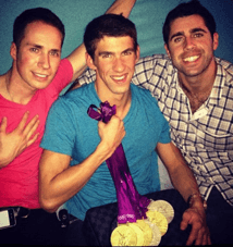 Phelps shows off his London medals in company with friends and poker players Jeff Gross (left) and Charlie Hook (right)