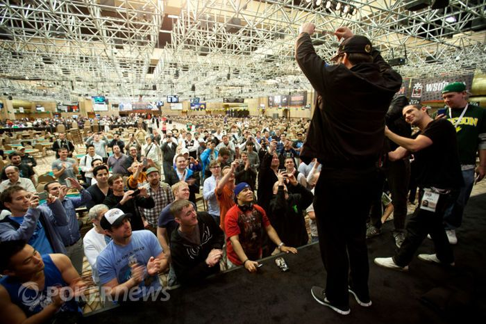 Hellmuth raises bracelet number 12 to the sky like a championship belt.
