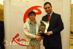 Tournament Champion Sae Jin Lee (L) with RWM Asst. VP Casino Table Games - Mr. Hakan Dagtas (R)