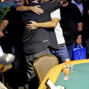 Jason Somerville gets a congratulatory hug by Daniel Negreanu.