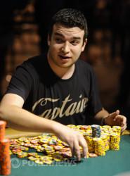 Chris Moorman stacks chips after winning a big pot.
