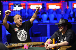 Eli Elezra cheers after winning a small pot as opponent, David Bach, is amused.