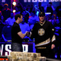 Brian Rast shakes Phil Hellmuth's hand.