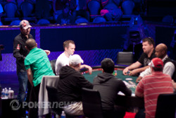Daniel Negreanu shakes Can Kim Hua's hand after busting him