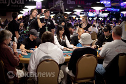 The cameras roll as Phil Hellmuth keeps his seat.