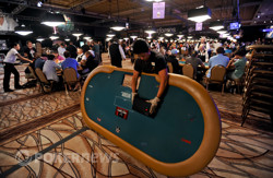 Rio employee Myrna Valdivia breaks down a poker table as the tournament area shrinks on Day 5.