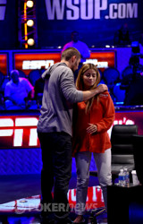 David Sands gives girlfriend, Erika Moutinho, a hug after he busted out in 30th place from the Main Event