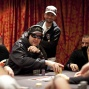Phil Hellmuth wins a big one against Vanessa Selbst, while Daniel Negreanu looks over.