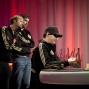 Daniel Negreanu and Jason Mercier look on at Phil Hellmuth heads up