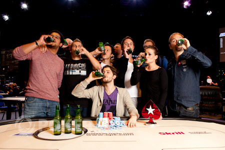Champion Igor Kurganov with friends and runner-up Daniel Negreanu