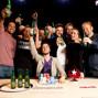 Champion Igor Kurganov with friends and runner-up Daniel Negreanu