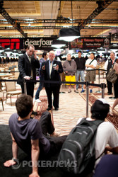 Joseph Cheong and Aubin Cazals conferencing with WSOP staff