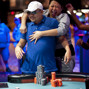 Dung Nguyen is mobbed by his wife, Janice after winning the bracelet