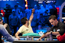 Antonio Esfandiari raises a fist towards his rail