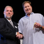 Nolan Dalla presents the gold bracelet to Event 53 winner Neil Willerson