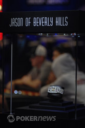 20120 WSOP Main Event bracelet on display at the main feature table