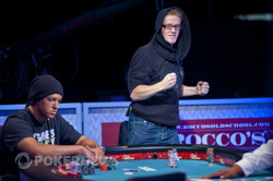 Charles Coultas, right, fist pumps after hitting his flush on the turn to eliminate Lasell King, left