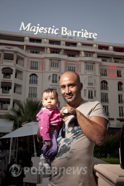 Imed Ben Mahmoud  holds his daughter and his new WSOPE bracelet