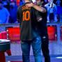 Greg Merson hugs Jesse Sylvia