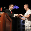 Jack Effel presenting the gold bracelet to Trevor Pope