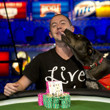 WSOP Gold Bracelet winner Trevor Pope gets a pooch smooch