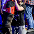 Trevor Pope is greeted by his dog, Revis, after winning event 02 at the WSOP.