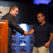 Jack Effel shakes hands with gold bracelet winner Cliff Josephy