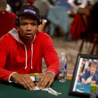 Poker Pro Phil Ivey is seated at the table with the honarary photo and chip stack for Dr. Jerry Buss.