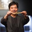 David Chiu shows off his gold bracelet