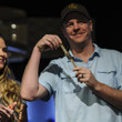 Erick Lindgren enjoys his gold bracelet with wife Erica